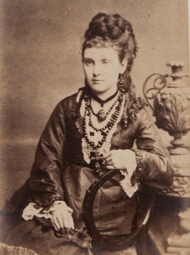 The elaborate, complex coiffures of the mid-Victorian era often used false hair including thick plaited sections, as seen in this photograph, early 1870s
