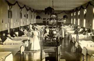 Women's ward in workhouse, maybe decorated for Christmas. PHOTOGRAPH by (unknown)