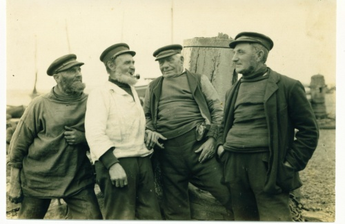 "Reproduction courtesy of Alan Hayes.  ""Spinning A Yarn"", L to R  Nick Humphrey, Tom Bassett (sail maker) Rolf and Taylor."