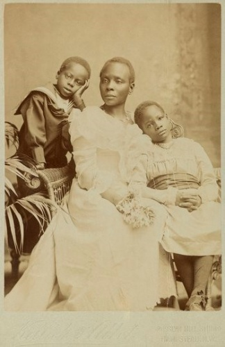 Sarah and two of her children. Queen Victoria was so proud of Sarah's daughter, Victoria, that when she passed her music examination, teachers and children were granted one day's holiday.  Photograph - Sacco.org.uk